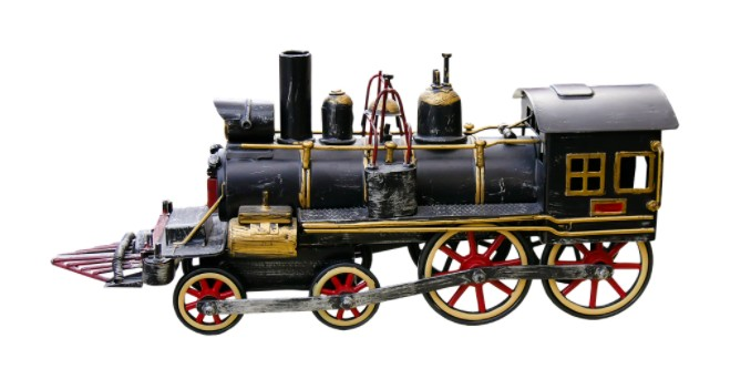 model train made from wood and metal, black model train, gold and red accent in the model train